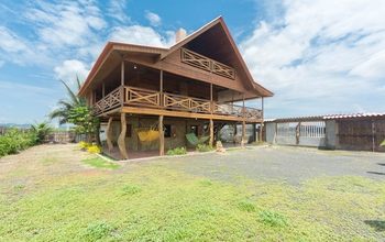 This charming beach wood house just a few meters …